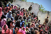 Street images from the destroyed city of Mogadishu... woman at a rally selebrating the mayor of the city.Death or Play. Women&acute;s Basketball in Mogadishu<br /> Women's basketball? In Europa and the U.S., we take it for granted. But consider this: In Mogadishu, war-torn capital of Somalia, young women risk their lives every time they show up to play.<br /> Suweys, the captain of the Somali women&acute;s basketball team, and her friends play the sport of the deadly enemy, called America. This is why they are on the hit list of the killer commandos of Al Shabaab, a militant islamist group, that has recently formed an alliance with the terrorist group Al Qaeda and control large swathes of Somalia.<br /> <br /> Al Shabaab, who sets bombs under market stands, blows up cinemas, and stones women, has declared the female basketball players &bdquo;un-islamic&ldquo;. One of the proposed punishments is to saw off their right hands and left feet. Or simply: shoot them.<br /> <br /> Suweys&acute; team trains behind bullet-ridden walls, in the ruins of the failed city of Mogadishu &ndash; protected by heavily armed gun-men. The women live in constant fear of the islamist killer commandos. Stop playing basketball? Never, they say.<br /> Women&acute;s basketball in the world&acute;s most dangerous capital. Female basketball in Mogadishu, Somalia.<br /> A deadly game..