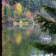 Fishing Alvord Lake in fall. Purcell Mountains, Kootenai National Forest, Lincoln County, northwest Montana.