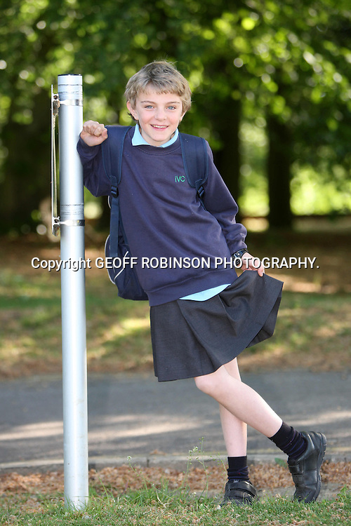 """PIC BY GEOFF ROBINSON PHOTOGRAPHY 07976 880732...EMBARGOED until 20:00 on Tuesday 22 November..FILE PIC DATED MAY 2011 SHOWS CHRIS WHITEHEAD AT SCHOOL IN IMPINGTON,CAMBRIDGE,WEARING A SKIRT AS A PROTEST TO NOT BEING ALLOWED TO WEAR SHORTS... A 13-year-old boy who wore a SKIRT to school in protest at a uniform ban on shorts has received a runner-up human right's prize...Chris Whitehead wore a short black girl's skirt for his classes at Impington Village College, Cambs, earlier this year because he believed its """"no shorts"""" policy discriminated against boys...The Year 8 student, who borrowed the skirt from his younger sister Joanna, 11, said wearing long trousers in the heat affected boys' concentration levels and ability to study in class...The school later promised to review its decision...Now Chris, who is a member of the school's student executive, has become a runner-up in Liberty's human rights young person of the year competition for his two-day demonstration...""""I didn't think it would be that influential, but I'm really happy, it was a good surprise to be nominated,"""" he said...SEE COPY CATCHLINE Boy in skirt runner-up human rights prize"""