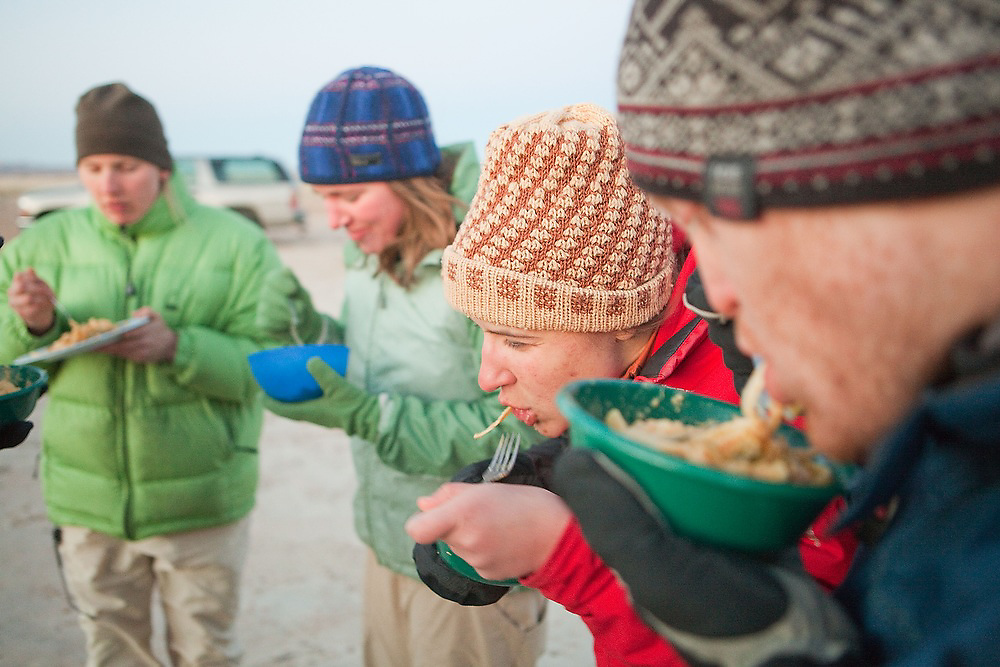 Megan O'Sadnick and other graduate students on a geology field trip with the University of Colorado eat pasta dinner together at their camp on BLM land near Hanksville, Utah.