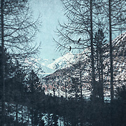 View at the snow capped mountains from a rest area on Julierstrasse  on our way through the Swiss Alps. Textured photograph