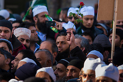 London, February 8th 2015. Muslims demonstrate outside Downing Street  to denounce the uncivilised expressionists reprinting of the cartoon image of the Holy Prophet Muhammad. PICTURED: A rose, symbolising peace and love is held aloft.