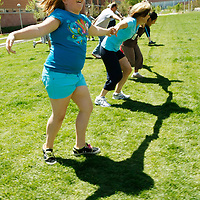 Jessie Matz, 11, participates in group exercise in the 10-week Shapedown Program at The Children's Hospital in Aurora, Colorado May 29, 2010.  The program is part of the child and teen weight management program at the hospital. REUTERS/Rick Wilking (UNITED STATES)