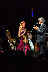 ANAHEIM, CA - JUN 9: Italian tenor Andre Bocelli performed Granada, New York, La Boheme, LaTraviata among others keeping audience mesmerized at the Honda Center in Anaheim, CA. The magical night included producer David Foster on Piano, Violinist Caroline Cambell, American Idol Season 3 winner Soul Singer Fantasia, Cuban Soprano Maria Aleida and Orchestra Conductor Eugene Kohn. Violinist Caroline Campbell (L) gets an applause from Andrea Bocelli (R) after performing. All fees must be agreed prior to publication, Byline and/or web usage link must  read  PHOTO: SilvexPhoto.com