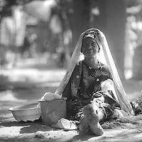 A woman sitting on the ground at the roadside market in Markala, near Ségou, Mali.