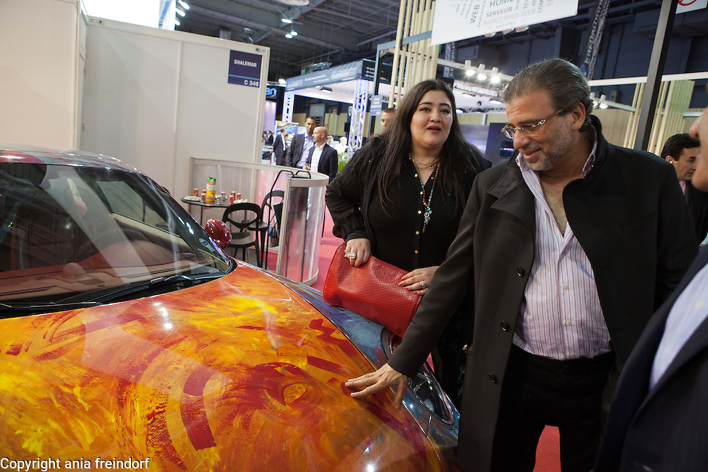 "Saudi artist Shalimar Sharbatly, ""Shalemar"" and her family, during the Salon Mondial Automobile. Her art painting on a Porsche car, Paris, France. (right) her husband Khaled Youssef, is an Egyptian director and film writer"