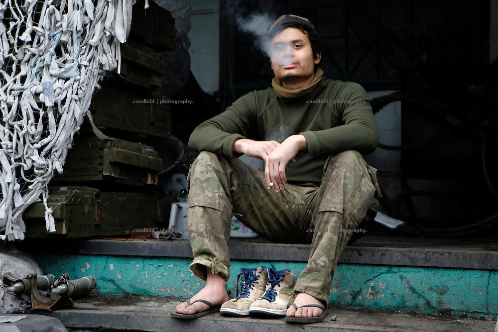 Charlie shows ths most important he keeps from his former life in the US: his sports shoes.<br />