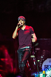 """LOS ANGELES, CA - OCT 11 Latin heartthrob Enrique Iglesias had the sold-out audience dancing from the floor to the rafters for the """"Sex and Love"""" tour with Pitbull in Los Angeles, USA. 2014 Oct 11. Los Angeles, USA. 2014 Oct 11. Byline, credit, TV usage, web usage or linkback must read SILVEXPHOTO.COM. Failure to byline correctly will incur double the agreed fee. Tel: +1 714 504 6870."""