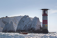 An RNLI RiB stands off the Needles lighthouse, Isle of Wight.<br /> Picture date: Saturday June 27, 2015.<br /> Photograph by Christopher Ison &copy;<br /> 07544044177<br /> chris@christopherison.com<br /> www.christopherison.com