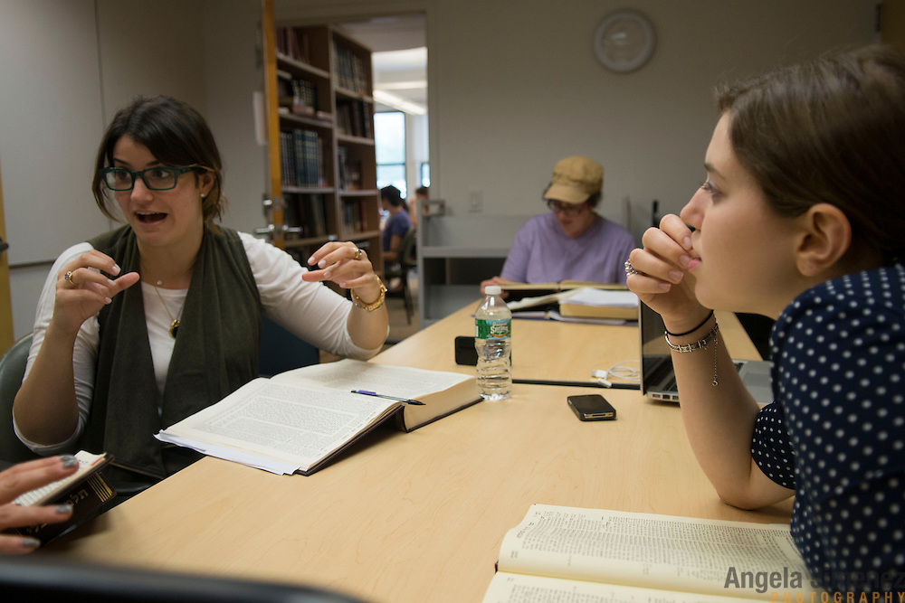 Maharat students Ramie Smith (Class of 2016), left, and Hadas &quot;Dasi&quot; Fruchter (Class of 2017), right, study with Talmud Chair Devorah Zlochower, center, at Drisha. <br /> <br /> The female students of Yeshivat Maharat, &quot;the first institution to train Orthodox women as spiritual leaders and halakhic authorities,&quot; study at the Drisha Institute in New York City in preparation for the school's inaugural graduation on June 16, 2013. <br /> <br /> Three women will be the first to graduate from the four-year school and will be given the title &quot;Maharat&quot;, a Hebrew acronym for &quot;Manhiga Hilkhatit Rukhanit Toranit&quot; which translates to a teacher of Jewish law and spirituality.The school, which currently has 14 students, was founded by Rabbi Avi Weiss. Rabbi Wiess controversially ordained the first female Orthodox Rabba in history, Rabba Sara Hurwitz, who serves as the dean of the school. <br /> <br /> Devorah Zlochower, one of the earliest female Talmudic scholars, was one of the Rabba Hurwitz' teachers when she was a student at Drisha. <br /> <br /> <br /> Photo by Angela Jimenez <br /> www.angelajimenezphotography.com