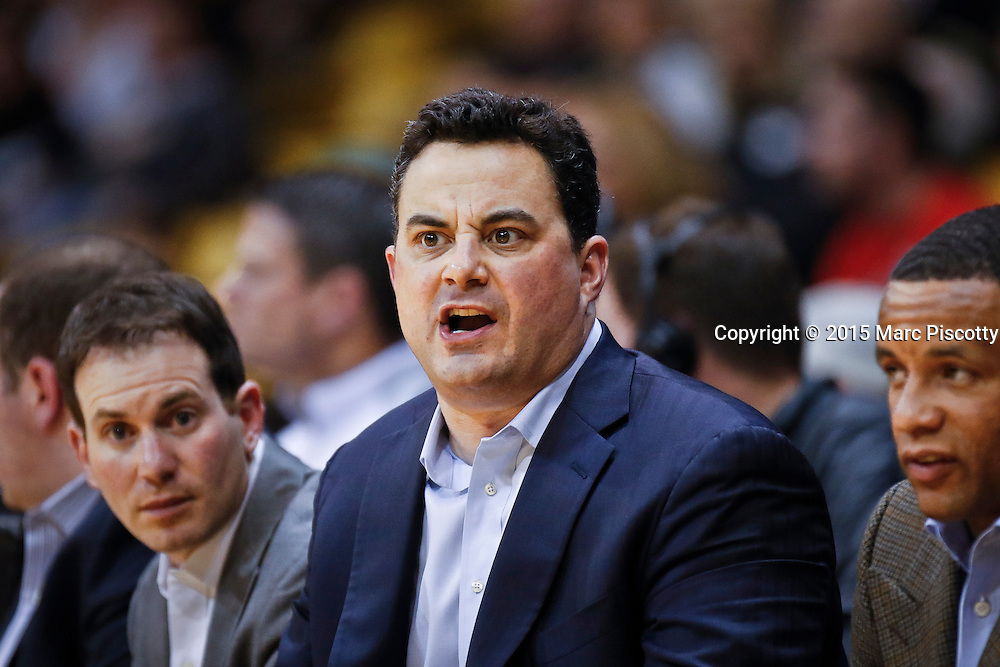 SHOT 2/26/15 9:59:08 PM - Arizona head basketball coach Sean Miller reacts as he watches his team play against Colorado during their regular season Pac-12 basketball game at the Coors Events Center in Boulder, Co. Arizona won the game 82-54.<br /> (Photo by Marc Piscotty / &copy; 2015)
