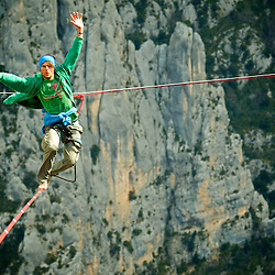Christian Krr and Alexander Schultz from Elephant Slacklines, perform the first attempts of slackline yoga in the first SPACE line, 300m high, and 65, 45,30m legs, rigged in the Sordidon sector of Verdon Gorges, France. ..©2012 Pedro Pimentel