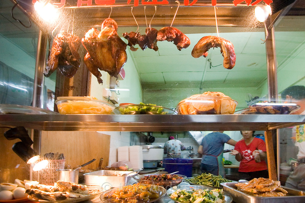 A food display showing duck and vegetables at a Chinese restaurant in Malaysia.