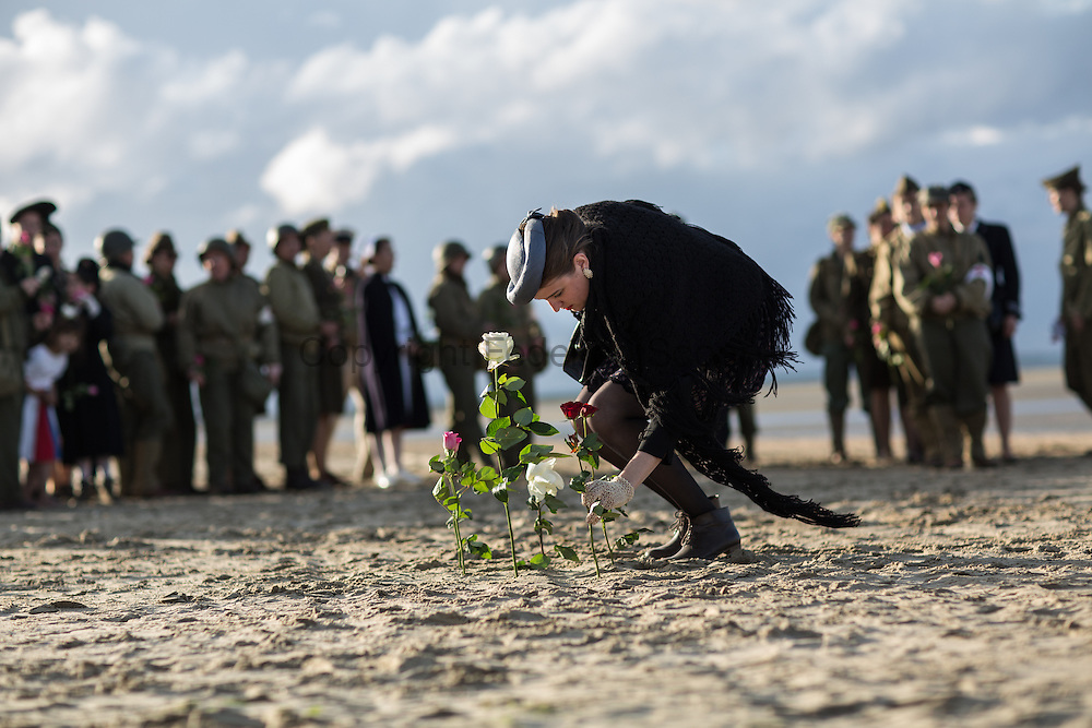 Reenactors gathering on Utah Beach for a ceremony onoring the WWII women