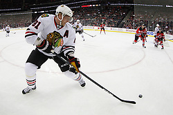 Mar 27; Newark, NJ, USA; Chicago Blackhawks right wing Marian Hossa (81) plays the puck during the first period of their game against the New Jersey Devils at the Prudential Center.