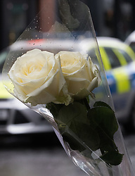 """Compton Street, Soho, London, June 13th 2016. A pair of white roses, a solemn memorial to the 50 people killed at gay club Pulse in Orlando on 12 June, is attached to the balustrade outside The Admiral Duncan, a LGBT-friendly bar that knows too well the price of homophobia, bombed by Neo-Nazi David Copeland on 30 April 1999, killing three people and wounding 70. The message on the card reads, """"Compton Street, Soho, London, June 13th 2016. A pair of white roses, a solemn memorial to the 50 people killed at gay club Pulse in Orlando on 12 June, is attached to the balustrade outside The Admiral Duncan, a LGBT-friendly bar that knows too well the price of homophobia, bombed by Neo-Nazi David Copeland on 30 April 1999, killing three people and wounding 70. The message on the card reads, """"To Orlando, LOVE IS LOVE! Soho stands with you."""" and is signed """"James and Talia"""". PICTURED: Old Compton Street appears to have a more visible police presence."""