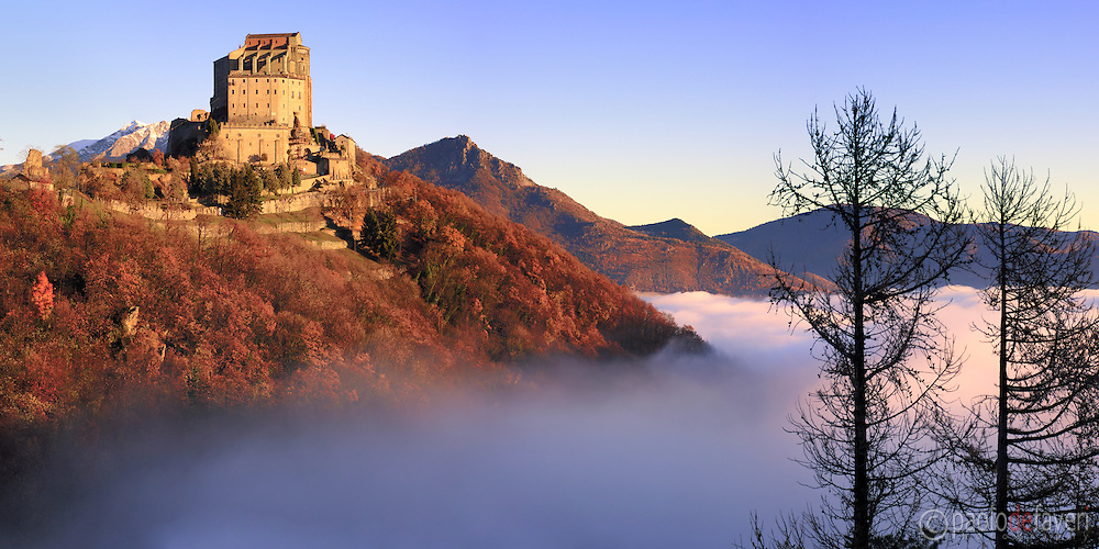 The millenarian benedectine abbey known as Sacra di San Michele emerging above an amazing sea of fog. Taken a few moments after sunrise on a very cold morning at the end of November, this is a stitch of 6 vertical frames.