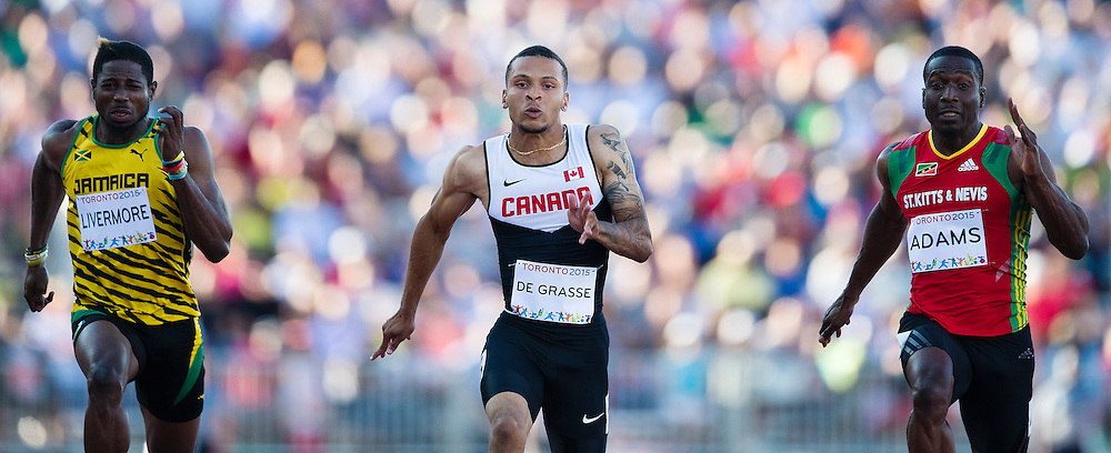 Andre De Grasse of Canada won the Men's 100m race in a time of 10.05 at the Pan Am Games in Toronto, Ontario on July 22, 2015.
