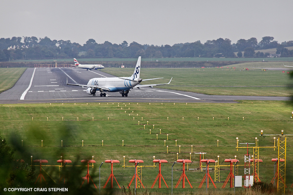 Two planes on the runway at Edinburgh airport, Scotland, UK