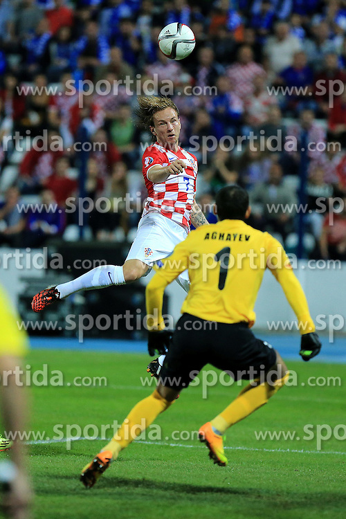 13.10.2014, Stadion Gradski vrt, Osijek, CRO, UEFA Euro Qualifikation, Kroatien vs Aserbaidschan, Gruppe H, im Bild Ivan Rakitic, Kamran Agayev // during the UEFA EURO 2016 Qualifier group H match between Croatia and Azerbaijan at the Stadion Gradski vrt in Osijek, Croatia on 2014/10/13. EXPA Pictures &copy; 2014, PhotoCredit: EXPA/ Pixsell/ Davor Javorovic<br /> <br /> *****ATTENTION - for AUT, SLO, SUI, SWE, ITA, FRA only*****
