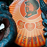 CHINA (Hong Kong). 2009. President Mao Zedong souvenir and traditional masks in Cat Street Market.