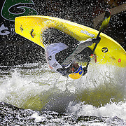 "SHOT 6/6/08 2:26:02 PM - Stephen Wright performs a ""loop"" in his freestyle kayak on Gore Creek at the 2008 Teva Mountain Games in Vail, Co. The games attract some of the world's best extreme athletes to compete in kayaking, bouldering, speed and dyno climbing, mountain bike freeride, big air, cross country and road racing, trail running, dog competitions and the GNC Ultimate Mountain Challenge. Wright is the current world champion in freestyle kayaking and is known for his high flying manuevers. Wright qualified for the finals and finished fourth..  (Photo by Marc Piscotty / © 2008)"