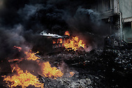 Violent clashes opposed protesters and riot police on Hrushevskoho street with baricades and police trucks set on fire in Kiev, 23 January 2014.