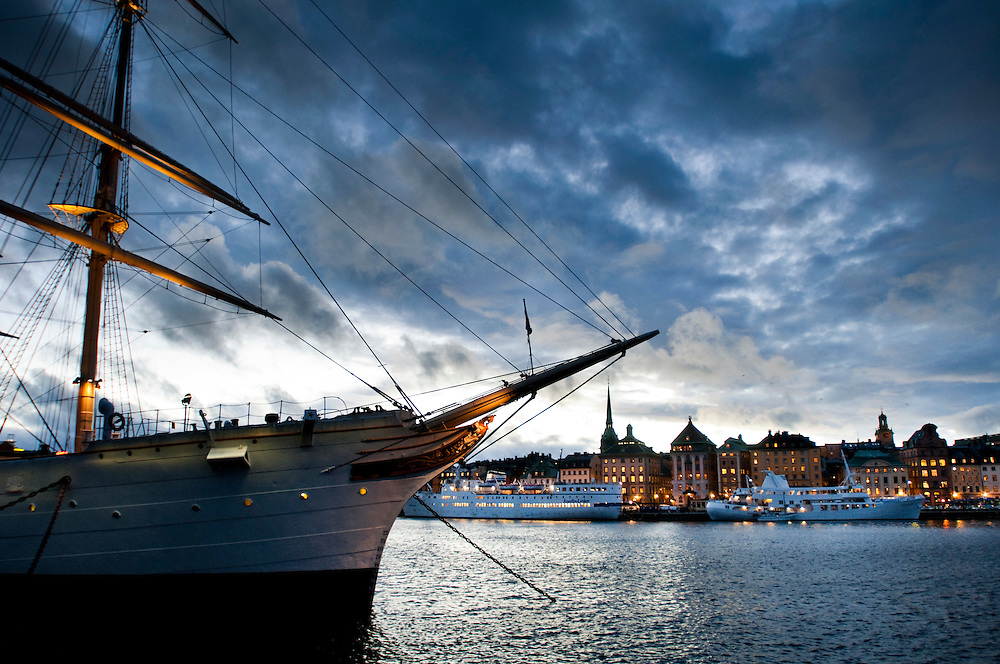 "View of Stockholm Old Town (Gamla Stan) from Skeppsholmen. The sail ship ""Af Chapman"" that is now a hostel in the foreground"