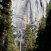 Yosemite Falls plunge 2425 feet (739 m) in several tiers, making it the highest waterfall in North America and seventh highest in the world. Yosemite National Park is in the Sierra Nevada of California, USA. Designated a World Heritage Site by UNESCO in 1984, Yosemite is internationally recognized for its spectacular granite cliffs, waterfalls, clear streams, Giant Sequoia groves, and biological diversity. 100 million years ago, the Sierra Nevada crystallized into granite from magma 5 miles underground. The range started uplifting 4 million years ago, and glaciers eroded the landscape seen today in Yosemite.