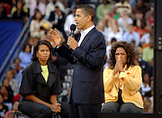 COLUMBIA, SC - DECEMBER 9: Democratic presidential hopeful Sen. Barack Obama (D-IL) (C) his wife Michelle (L) and talk show host Oprah Winfrey (R) address a crowd from the stage at a campaign event December 9, 2007 in Columbia, South Carolina. Obama and Winfrey are scheduled to make one more stop in New Hampshire today. (Photo by Stephen Morton/Getty Images)