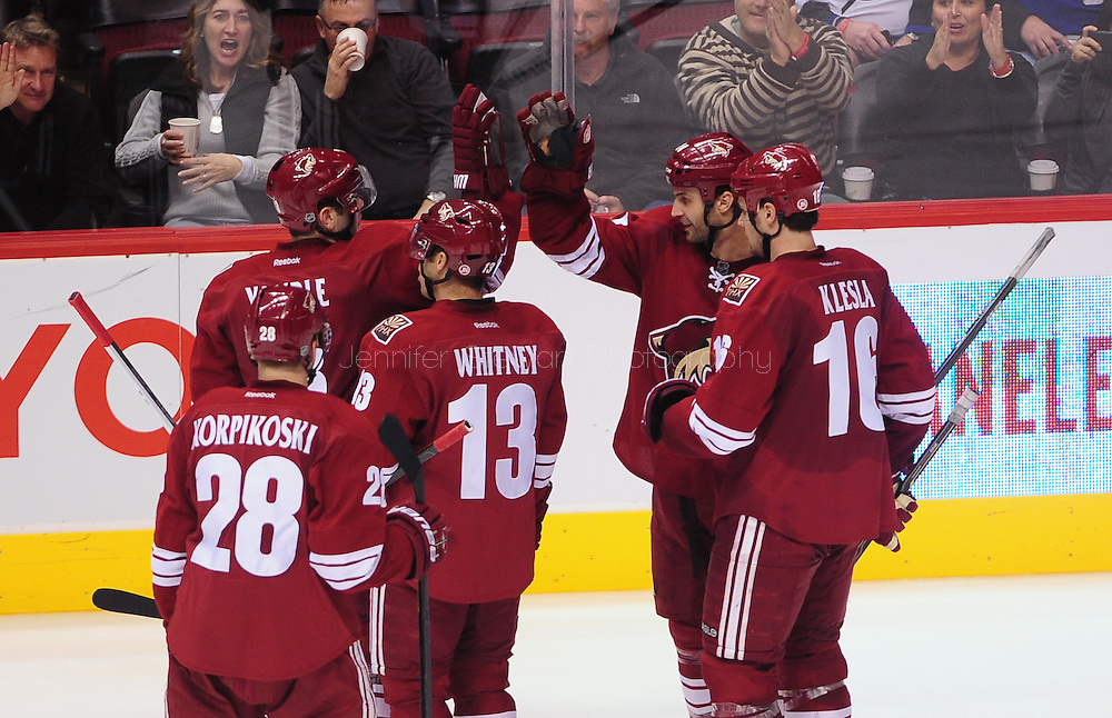 Jan. 21 2012; Glendale, AZ, USA; Phoenix Coyotes defensemen Keith Yandle (3) is congratulated by teammates after scoring against the Tampa Bay Lightning during the third period at Jobing.com Arena. The Lightning defeated the Coyotes 4-3. Mandatory Credit: Jennifer Stewart-US PRESSWIRE