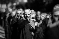 Men on the procession through the Dahiyeh district wore headbands celebrating Abbas, brother of Imam Hussein.