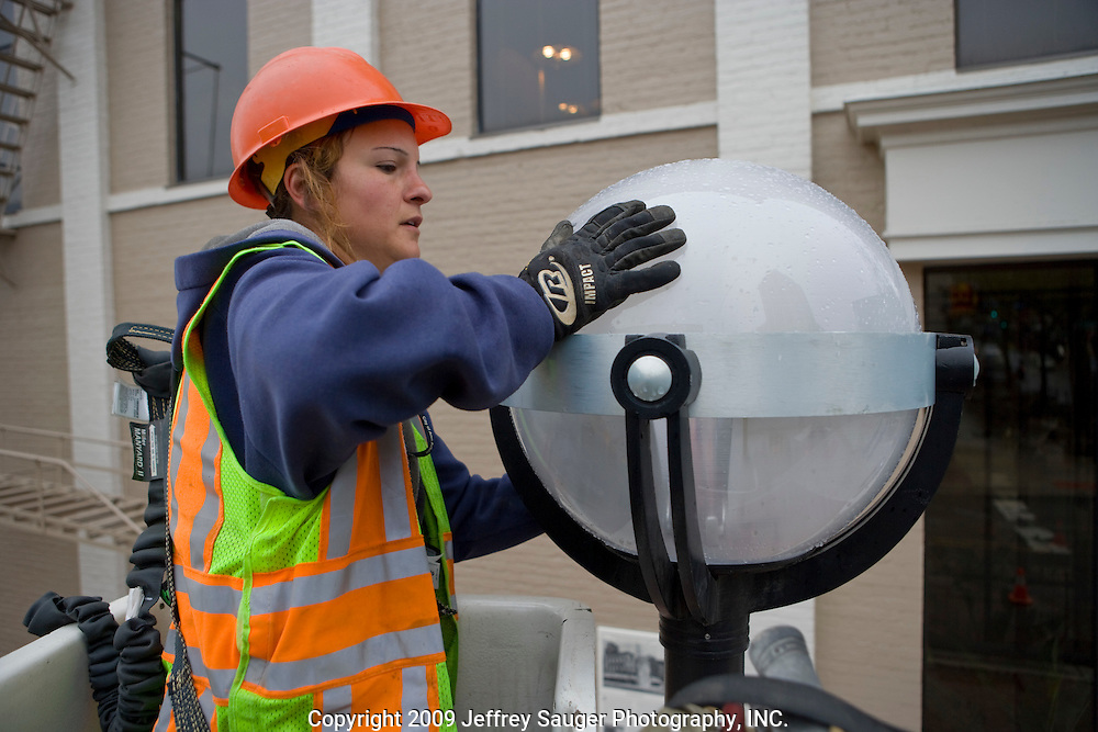 Steffeni Hottenstein, 34, a communications technician for the City of Ann Arbor Public Services, works on an LED streetlight made by Relume Technologies, Inc., at the intersection of S. Main and W. Washington in Ann Arbor, MI, Thursday, May 7, 2009.