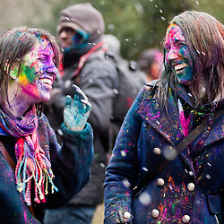 London, UK - 23 March 2013: two girls laughs during the Holi Spring Festival of Colour that takes place at Orleans House Gallery in Twickenham. The annual event marks the end of Winter and welcomes the joy of spring. This year it took place under heavy weather conditions.
