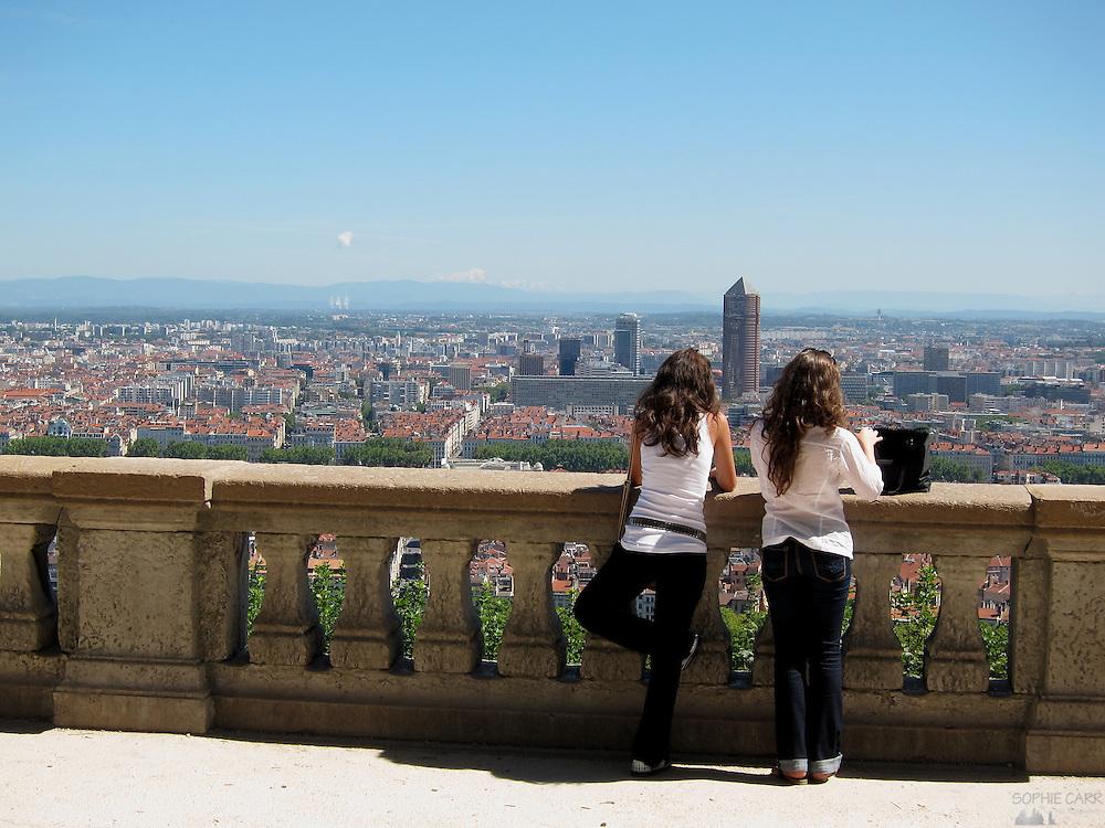 Tourists enjoy a view of Lyon, France, seen from the Basilica of Notre-Dame de Fourvière