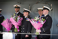 Officers with bunches of flowers wait patiently onboard as the type 23 frigate HMS Richmond returns to Portsmouth Royal Navy Base following a seven-month deployment to the South Atlantic. Picture date: Friday 21st February, 2014. Photo credit should read: Christopher Ison. Contact chrisison@mac.com 07544044177