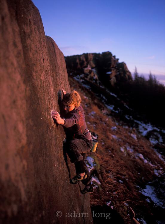 Hazel Findlay bouldering on Little Skyline slab. The Roaches, Staffordshire