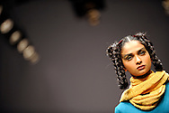 A model wears a creation by Rahul Reddy during the New Delhi Fashion Week in New Delhi, India March 22, 2009. Photo by Keith Bedford