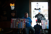 Michael Goodart sells campaign memorabilia ahead of Republican U.S. presidential candidate Ted Cruz' campaign stop at Prime Time Restaurant in Guthrie Center, Iowa on January 4, 2016.