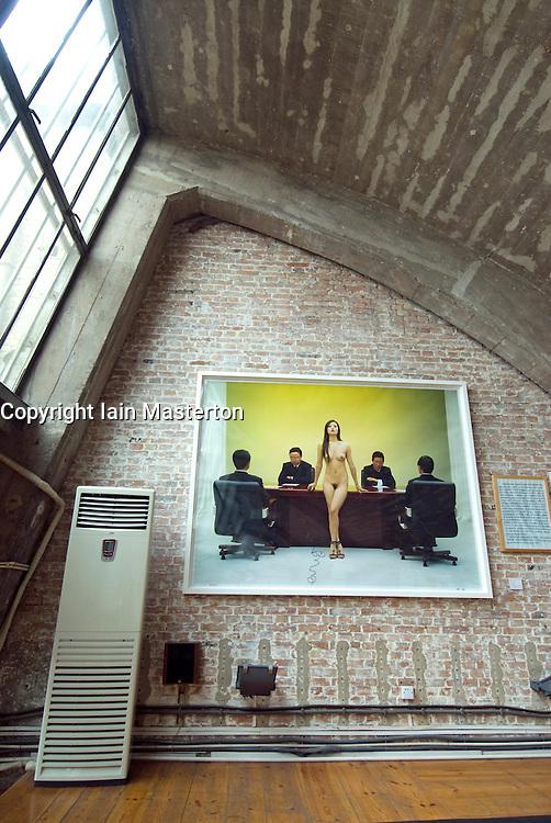 Nude photographic exhibit in gallery at trendy 798 Art District in Beijing