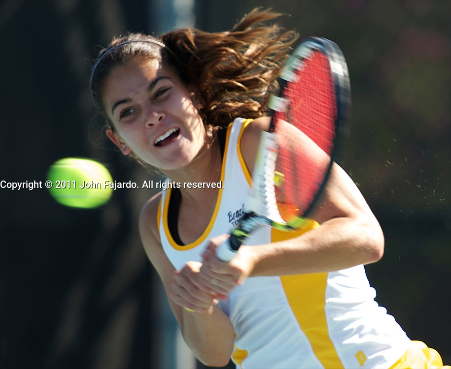 Anais Dallara returns the ball in singles play against Nevada's Michelle Okhremchuck