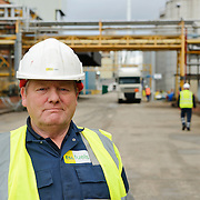 Portrait of worker at an oil storage facility
