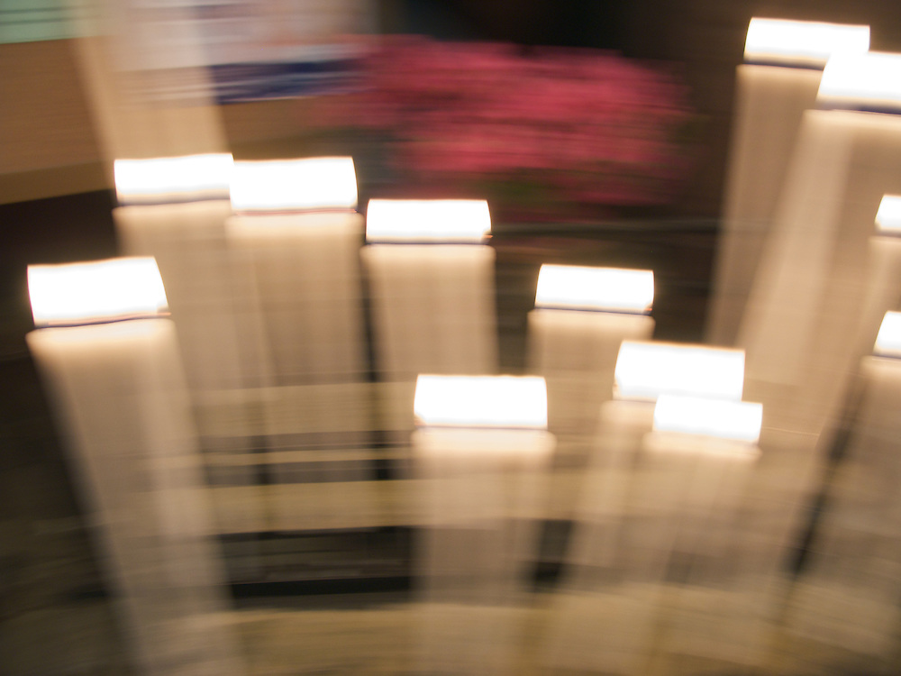 Candles in the cathedral in Aire sur l'Adour in the Landes department of the South-West of France. The camera movement gives the candles a blurred appearance.