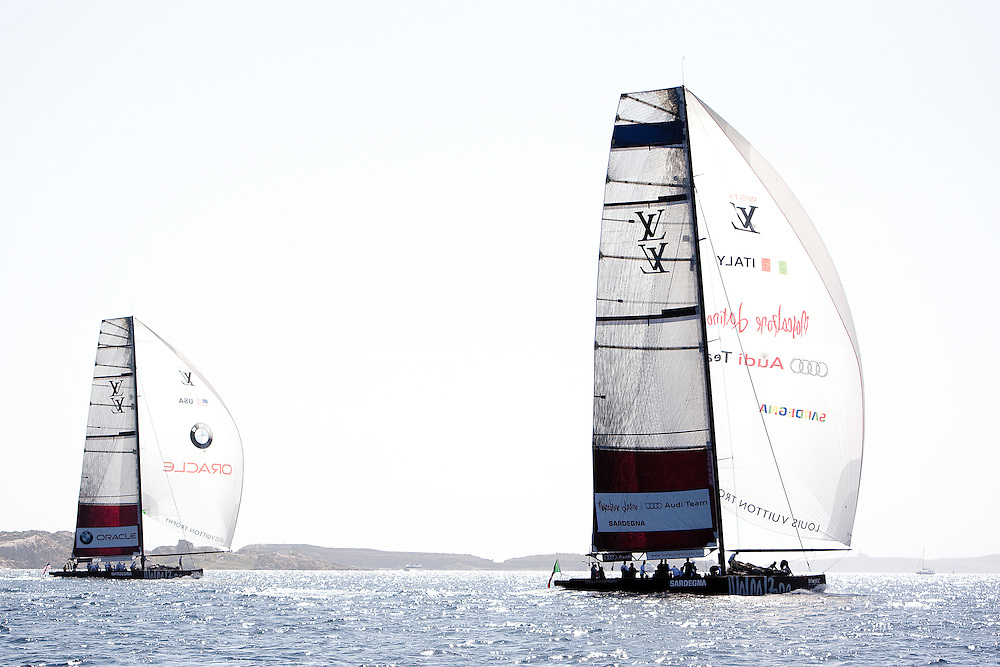 Mascalzone Latino trails BMW Oracle at the Louis Vuitton Trophy, La Maddalena, Italy. 1 June 2010. Photo: Gareth Cooke/Subzero Images