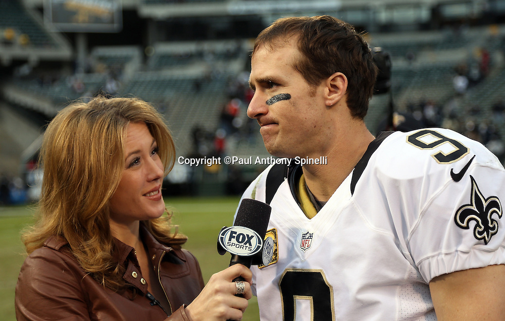 New Orleans Saints quarterback Drew Brees (9) does a postgame interview with Jennifer Hale of FOX Sports after the NFL week 11 football game against the Oakland Raiders on Sunday, Nov. 18, 2012 in Oakland, Calif. The Saints won the game 38-17. ©Paul Anthony Spinelli