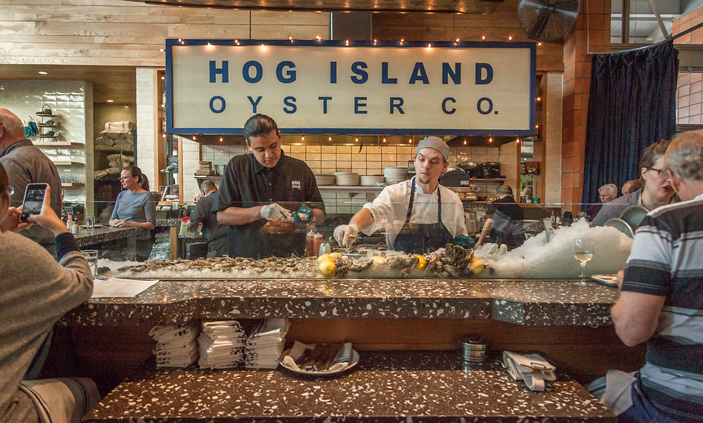 Oyster shuckers at Hog Island Oyster Co. at the Oxbow Market in Napa
