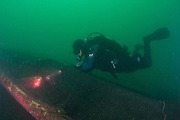 GUE (Global Underwater Explorers) diver inspects abandon ghost net on Old Marineland Platform.