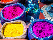 12 MARCH 2017 - BHAKTAPUR, NEPAL:  Holi powder for sale at a Holi celebration in Bhaktapur. Holi, a Hindu religious festival, has become popular with non-Hindus in many parts of South Asia, as well as people of other communities outside Asia. The festival signifies the victory of good over evil, the arrival of spring, end of winter, and for many a festive day to meet others. Holi celebrations in Nepal are not as wild as they are in India.    PHOTO BY JACK KURTZ