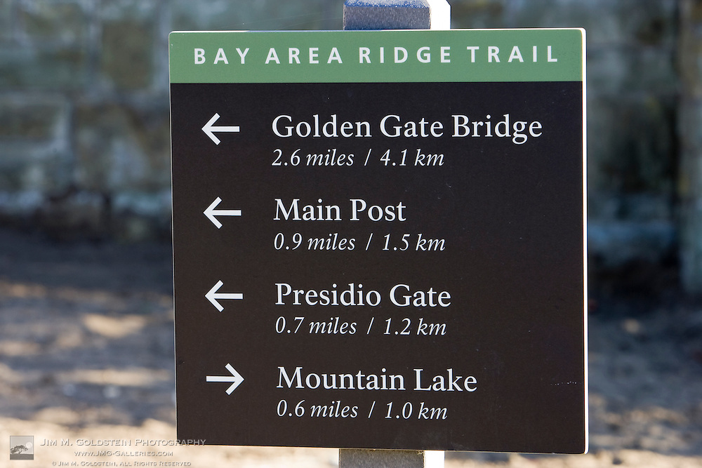 Bay Area Ridge Trail sign with mile markers to the Golden Gate Bridge, Main Post, Presidio Gate and Mountain Lake