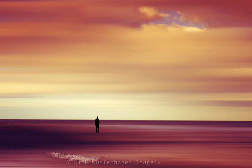 Abstraction of a Person standing at the sea on a wavebreaker